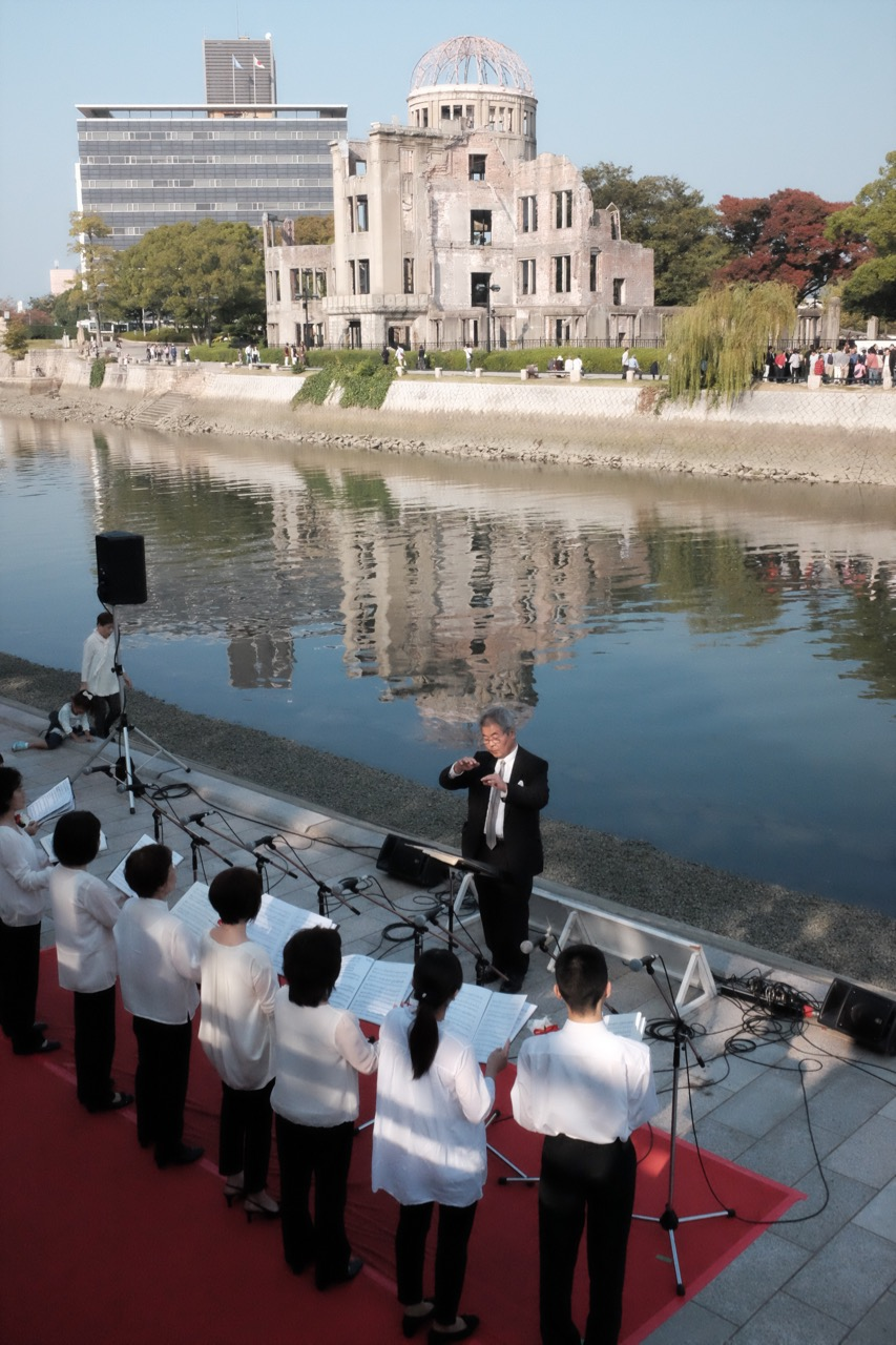 Choir with genbaku dome in the background.